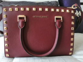 Burgundy Michael Kors Medium Studded Handbag.