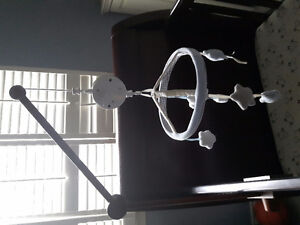 pottery barn crib mobile and wooden arm