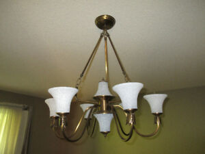 Chandelier - brass finish. White Glass Shades are removable.Ver