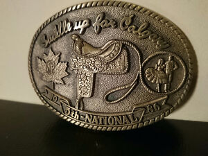 "1986 BRASS BELT BUCKLE ""Saddle up for Calgary""5th National Dance"