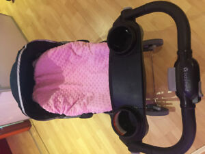 Car seat with a baby warming blanket cover and stroller base