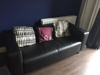 Black 2 seater leather style sofa