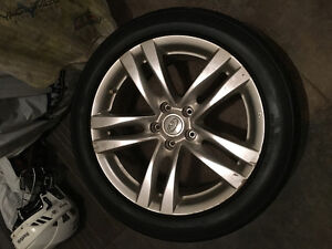 Selling 4 Infiniti rims and brand new tires