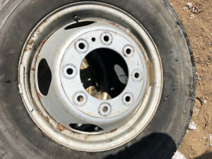 A set of 4 tires and rims and inserts to fit GMC 3500 dually