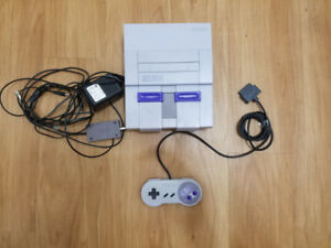 Super nintendo console with controller and hookups