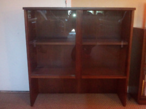 Top of  buffet hutch used as a book case bookcase book shelve