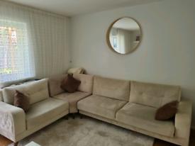 Cream L-shaped sofa