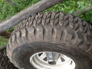 four 35'' x 12.5 Bigfoot mud tires as new (95%) on Jeep wheels