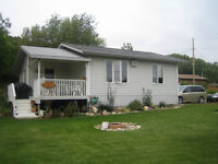 Sand Point Buffalo Pound Cottage for Sale