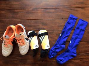Nike soccer cleats, Adidas shin guards, Adidas royal blue socks