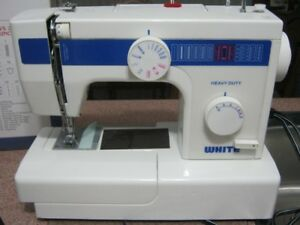 sewing machine with manual, essentials and original box