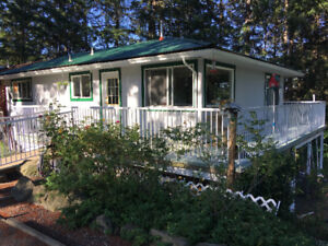 1/2 duplex with full mortgage helper on Vancouver Island