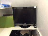 "Sharp LCD colour tv on 20"" stand and with original remote, full working order"