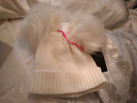 Infants woollly hat with pom poms. Very,verycute