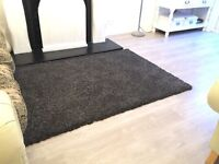 Black/grey shaggy rug