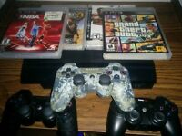 PS3 slim with 3 games and 3 controllers