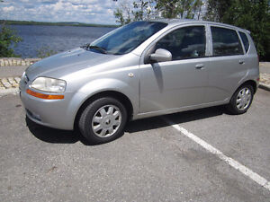 2005 Chevy Aveo 5 automatic, winter tires included.