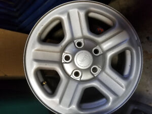 16 inch jeep wrangler rims  like new 150 obo