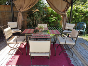 Indoor/Outdoor wrought iron glass table with 6 leather chairs