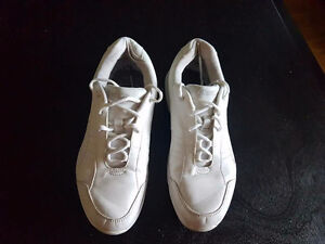 Size 7 Kaepa Cheer Sneakers with colored inserts.