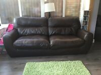 Brown 3 seater and chair