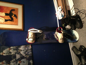 Rossignol snowboard with size 9 boots