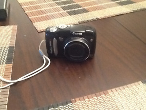 10 megapixel Canon Camera with built in pop up flash