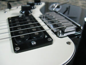 Player's Fender Strat with extra pickguard