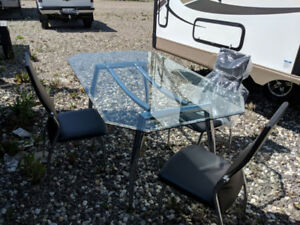 Glass table and six chairs