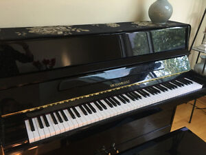 Black stand piano for sale
