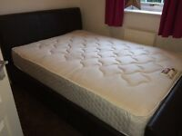 Dark brown leather double bed