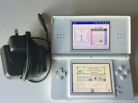 Polar white Nintendo ds lite console and charger