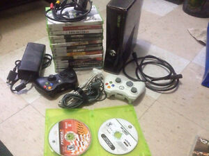 xbox 360, all cables, lots of games and 2 controllers. (batterie