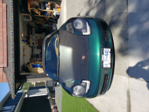 2000 Porsche boxster.  124000k. excellent condition