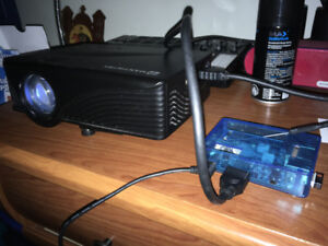 Mini Kodi pc with projector and keyboard with trackpad
