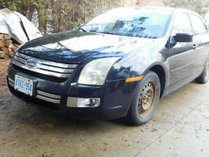 2006 Ford Fusion SEL V6 with 2 sets of tires on rims