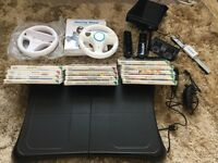 14 Games Black Wii Fit Board, Console, Rechargeable Controllers Package + Mario Kart