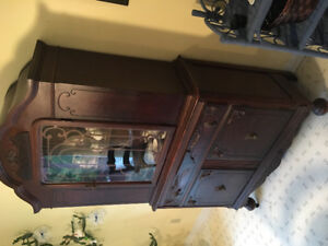 Antique china cabinet 90+ years old.
