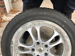 Never Used Set of Four All Season Tires with Mag Rims
