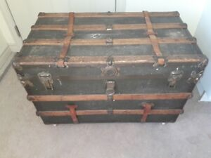 Antique flat top trunk with refinished interior and tray.