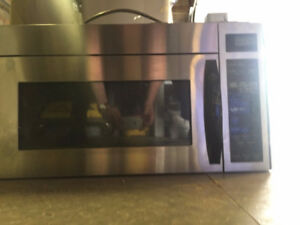 Microwave, built in with hood fan, GE Profile, Used