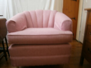 Pink upholstered tub chair with swivel option
