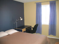 Furnished Bedroom with Semi-Private Bathroom for Female