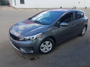 2017 Kia Forte 5, 6 speed, loaded, backup cam, only 6,000 km.