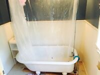 Claw foot bathtub, all taps and curtain rod accessories.