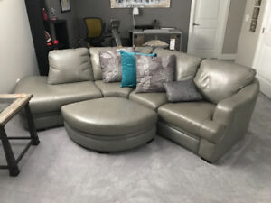 Grey leather sectional and ottoman