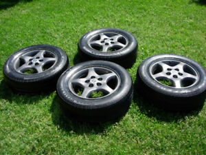 4 great condition tires with the original mag for GM 215 60 16