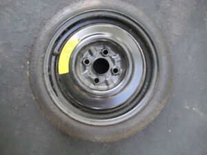 Spare tire compact for Ford Escort