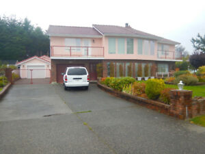 Parksville home on quiet cul de sac with lovely views. $759,000.