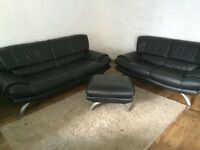 Black Italian genuine leather 3&2 seater sofa's and footstool from dfs